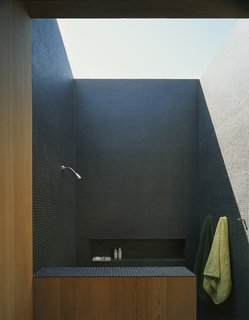 The house was conceived as a summer home, to take advantage of the sounds, breezes, views and lighting – even in the shower. Courtesy Architects and Artisans.