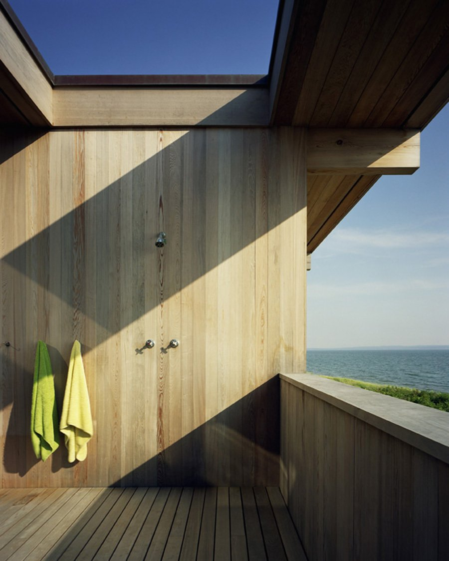 Outdoor, Vertical, Wood, and Shower Reclaimed and recycled cypress beams measure 16 inches tall, six inches wide and are 36 feet long. Courtesy Architects and Artisans.  Best Outdoor Shower Photos from Shelter Island Retreat