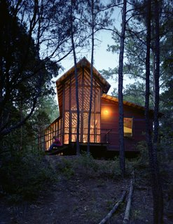 """""""I wanted more of a skeletal look for this house, and less of a chunky, log-cabin look,"""" says Panton, who added stark steel bracing across the entire length of the porch's roof structure."""