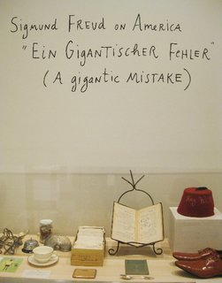 """Alongside her work, loads of Kalman's collected ephemera is on display as part of Maira Kalman Various Illuminations (Of a Crazy World). It contains just the kind of objects she loves to paint, from a pair of Junya Watanabe shoes to a vintage fez to a box of cards cataloging the """"Mosses of Long Island.""""  Maira Kalman: Various Illuminations (of a Crazy World), Installation detail. Contemporary Jewish Museum, San Francisco."""