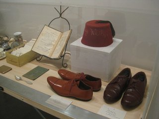 """Here's another view of that vitrine with Kalman's ephemera. She told me that she wore the brown shoes, which are too big for her, """"in the hope of slowing down time."""" She then mimed slow, massive steps for me as we continued around the gallery.  Maira Kalman: Various Illuminations (of a Crazy World), Installation detail. Contemporary Jewish Museum, San Francisco."""