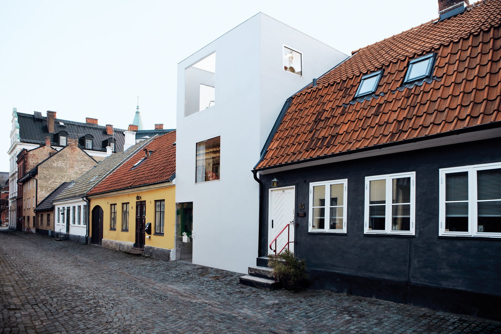 Exterior, House Building Type, Stucco Siding Material, and Flat RoofLine As you ascend towards the roof, the house becomes increasingly transparent.  Photo 6 of 14 in A Contemporary Nordic Town House