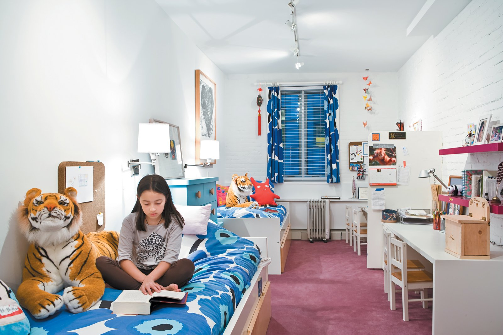 Carpet, Bed, Kids, Night Stands, Dresser, Shelves, and Storage The girls' narrow bedroom gets natural light from a single window. White paint and furniture (accented with Marimekko print linens) keep the space feeling bright.  Best Kids Carpet Bed Shelves Photos from Fine Dine-ing