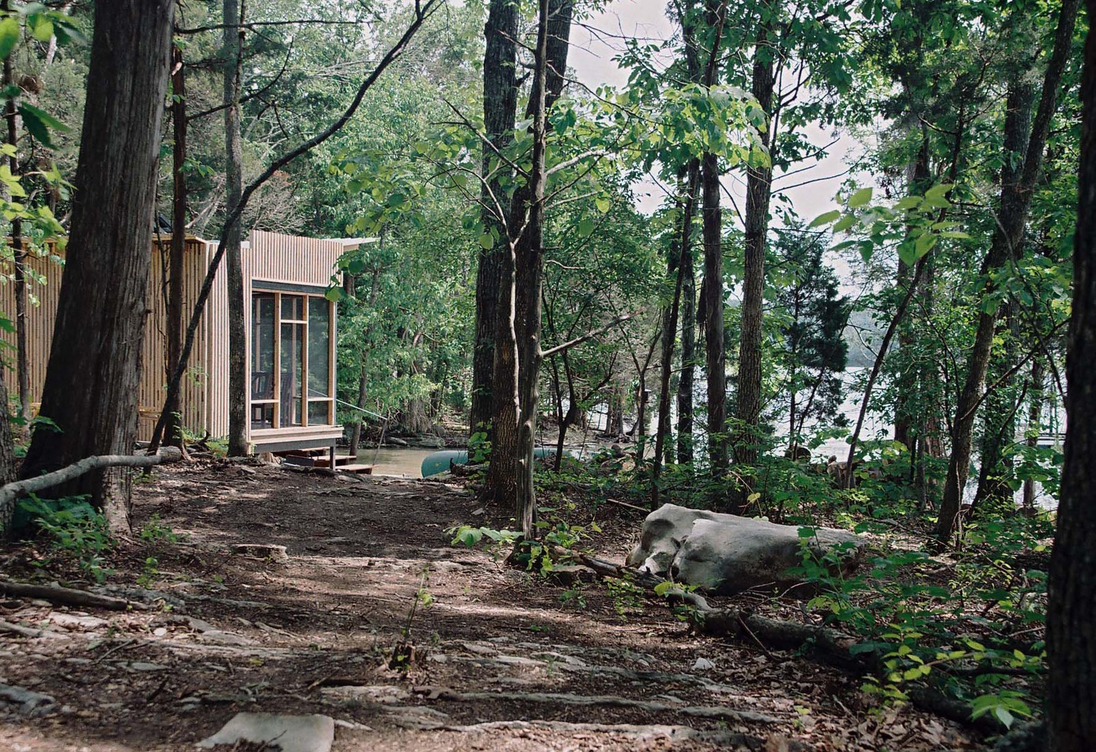 "Outdoor and Trees Suzanne Shelton built a ""little cottage to get away to"" on Tennessee's Norris Lake that's equipped with both rainwater-harvesting and solar-power systems for off-the-grid living.  Photo 3 of 4 in How to Build an Off the Grid Cabin"