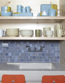 The Ferry Building shop displays seasonal goods as well as items from some of Heath's most popular collections. The backsplash is Heath dual glaze tile in tones of blue that creates a dynamic pattern and hints at the water that collects in the sink.