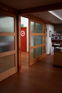Upcycled Sliding Doors  Submitted by: Name not provided  Designer's Description:   Constructed from reclaimed and recycled materials with an open floor plan that facilitates communication, the remodeled space embodies the fine craftsmanship, environmental stewardship, and management excellence that have characterized Hammer & Hand for the past fifteen years.