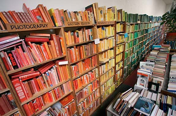 Artist Christopher Cobb and helpers reshelved all the books in the San Francisco shop Adobe Books according to color for his work  Photo 2 of 3 in Shelved By Color