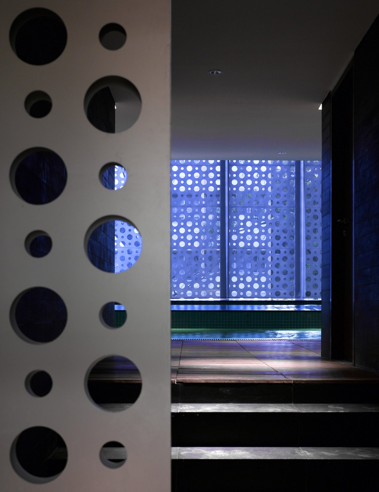 The sliding-gate entrance to the residents' private, 4,900-square-foot pool and gym area.  Photo 11 of 17 in A Modern Aesthetic in Mumbai
