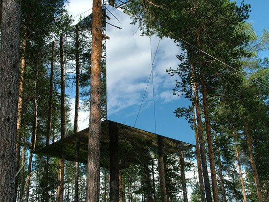 Treehotel owners Britta Jonsson Lindvall and Kent Lindvall enlisted six designers to create the 13-by-13-foot Mirrorcube, a reflective glass cube built around the trunk of a pine. It blends into the surrounding forest so well that the architects plan to cover it with a transparent ultraviolet film to alert flying birds, so they won't smash into it. Click here to see the interior and other modern tree house designs.  Modern Treehouses by Aileen Kwun from Swedish Treehouse Fantasy