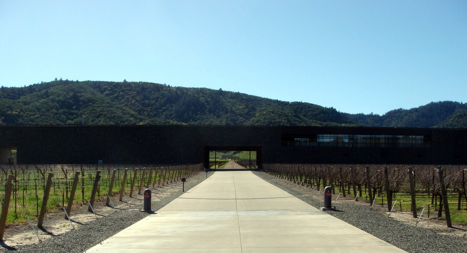 Exterior, Stone Siding Material, House Building Type, Flat RoofLine, and Metal Siding Material Completed in 1997, the Dominus Estate was the first project built in the United States by Swiss architects Herzog + de Meuron.  Photo 1 of 9 in The Stealth Winery