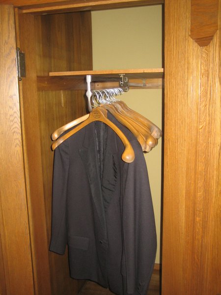 """This clothes rack in the hall closet pulls out thanks to a mechanism May used in his store. Wright was such a tyrant when it came to alterations of his design, but as this is an original fixture it looks like the architect made a concession to May's display techniques. It pulls quite far out, a necessity as the closets are very deep and May himself was a rather diminutive 5'4""""."""