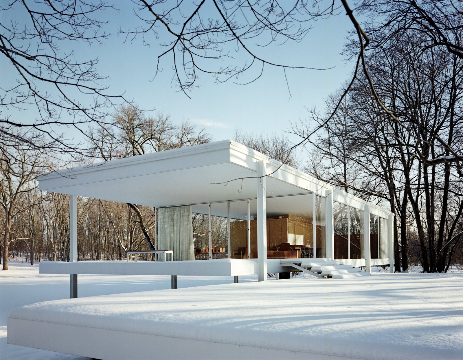 Exterior, Cabin Building Type, House Building Type, Metal Siding Material, Flat RoofLine, Glass Siding Material, and Mid-Century Building Type Here's the cover image in all its glory. Van der Rohe's Farnsworth House is the essential glass house (sorry Philip J) and looks pretty spectacular in the snow. One wonders if those windows are double-paned though. Photo by Jason Schmidt.  Best from Best Midcentury Homes in America