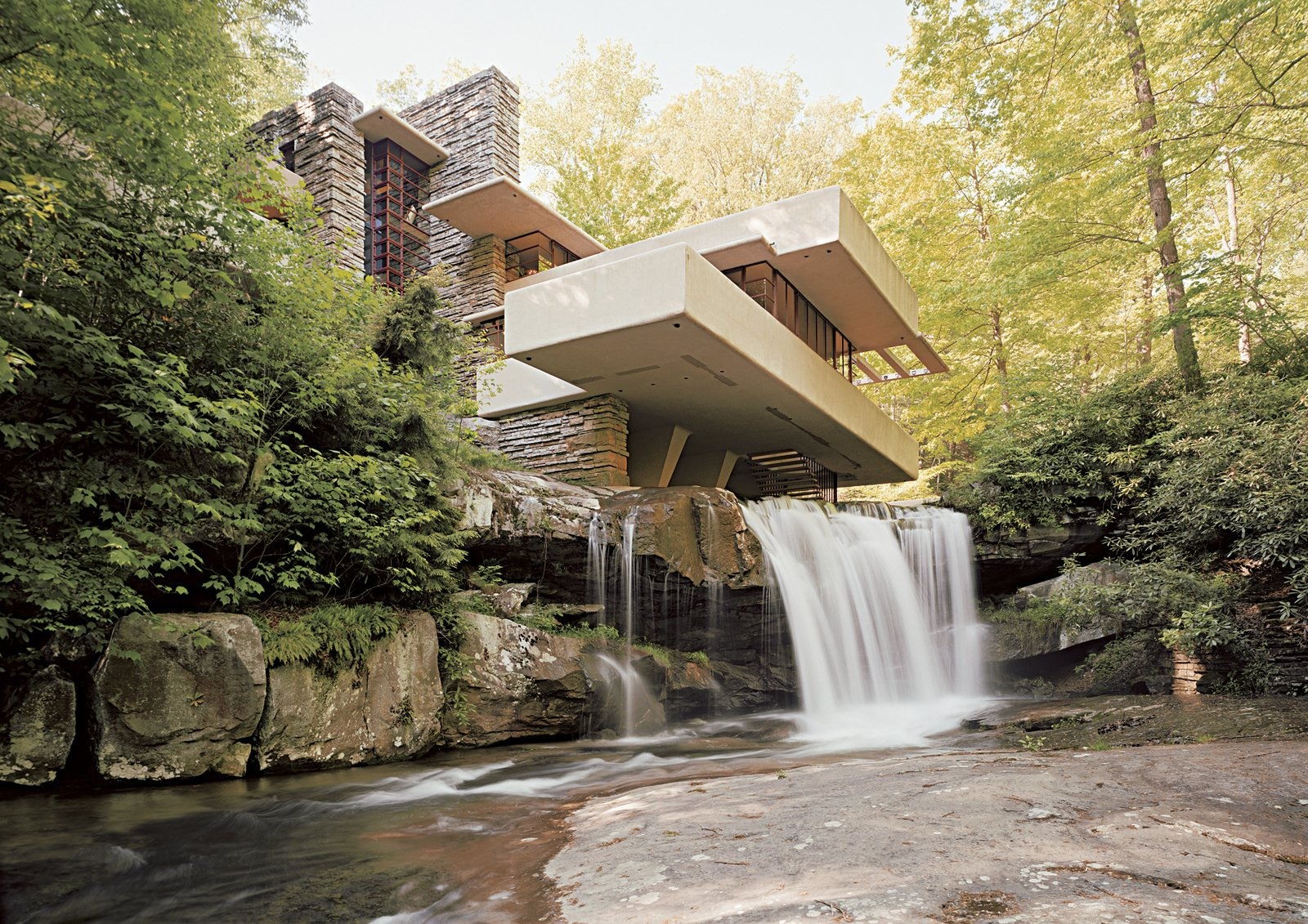 The Babe Ruth of American residential design, Fallingwater by Frank Lloyd Wright continues to dazzle with its shifting planes hovering over the creek. Photo by Victoria Sambunaris  Best Midcentury Homes in America by Aaron Britt