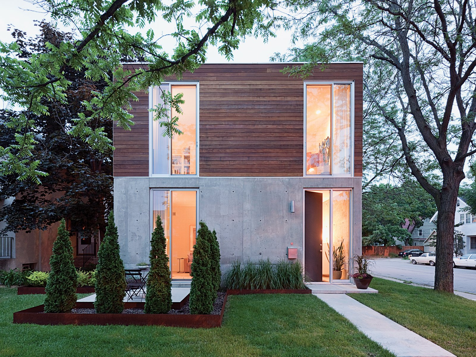"Exterior, Wood Siding Material, Concrete Siding Material, House Building Type, and Flat RoofLine ""I simply was drawn to the notion of concrete. So much great modern architecture has made use of it,"" Blauvelt says.  Best Photos from Modern Urban Retreat in South Minneapolis"