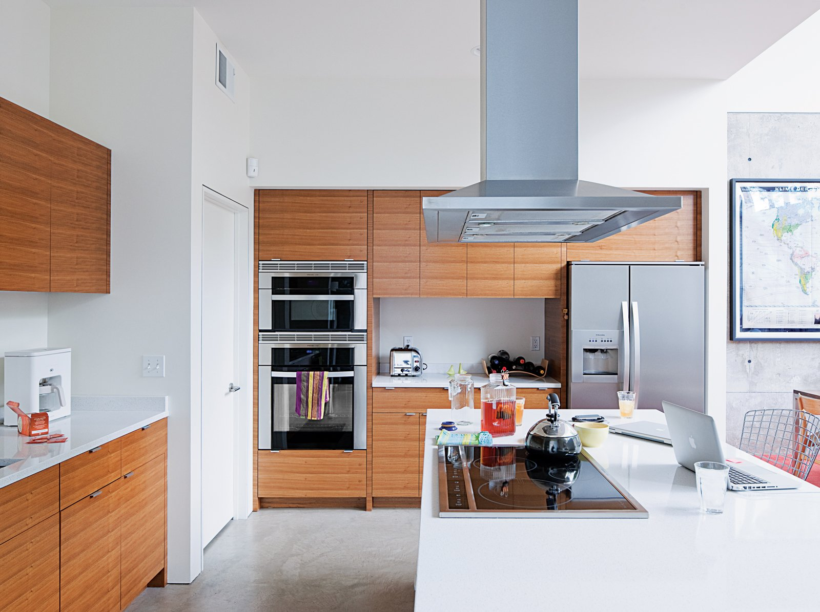 The kitchen features cabinets by carpenter James LaChance, Hanstone quartz countertops, Electrolux Icon Series appliances, and a Jenn-Air exhaust hood.  Photo 8 of 29 in Modern Urban Retreat in South Minneapolis