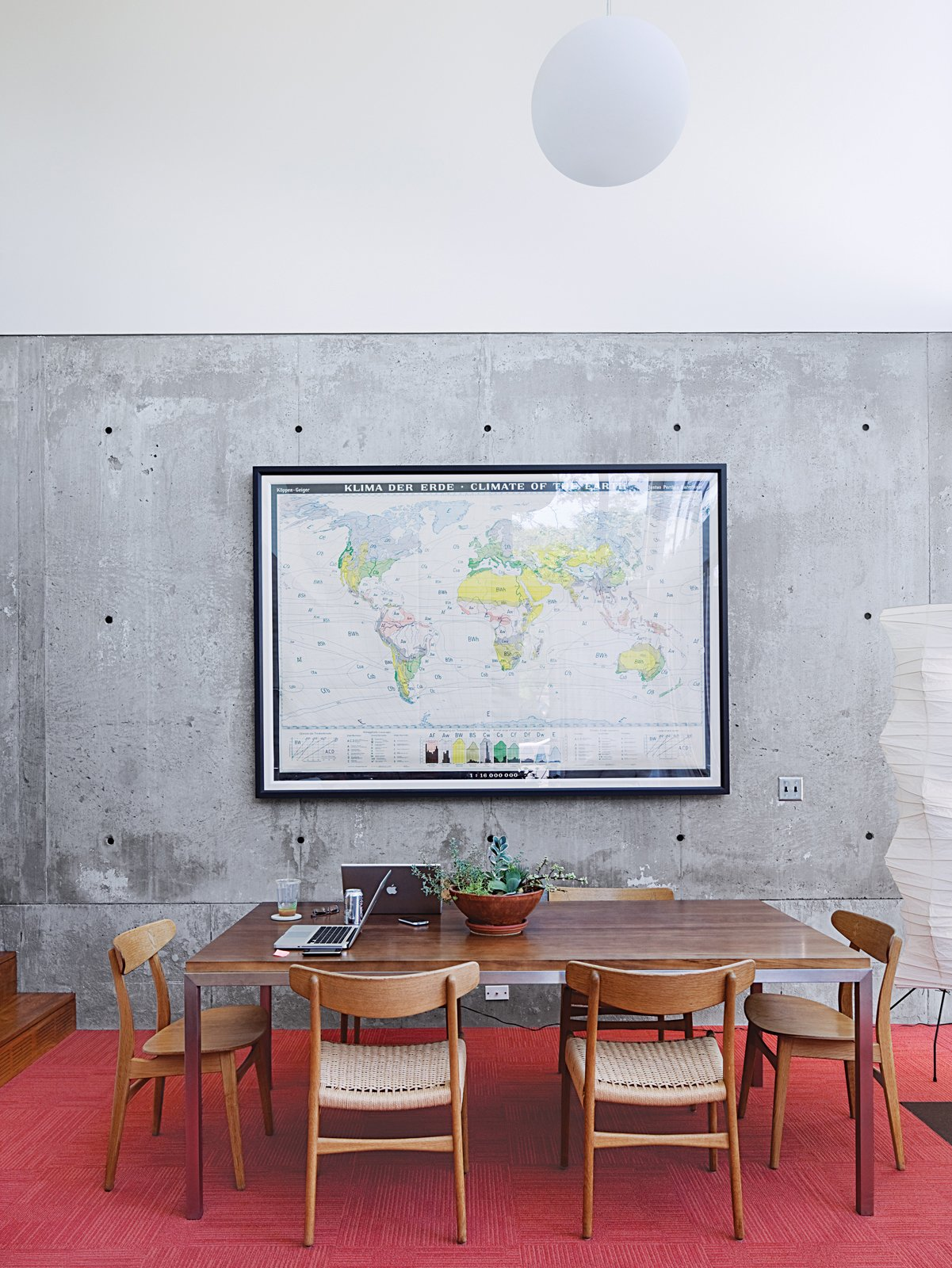 Dining Room, Table, Chair, Pendant Lighting, and Floor Lighting A monumental German climate map enlivens the dining area, which also sports CH 23 & CH 30 chairs by Hans Wegner.  In the Home from Modern Urban Retreat in South Minneapolis