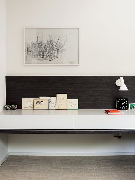 Deam also designed all of the built-in furniture, including this bedside console that features an Arne Jacobsen sconce.