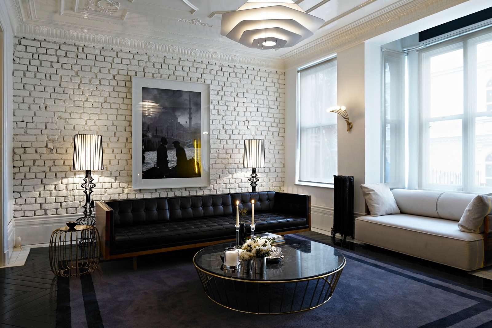 For another residence in Turkey, the pair used brass and leather as luxurious counterpoints to whitewashed brick.  exposed brick from Autoban and their House Hotel
