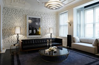 For another residence in Turkey, the pair used brass and leather as luxurious counterpoints to whitewashed brick.