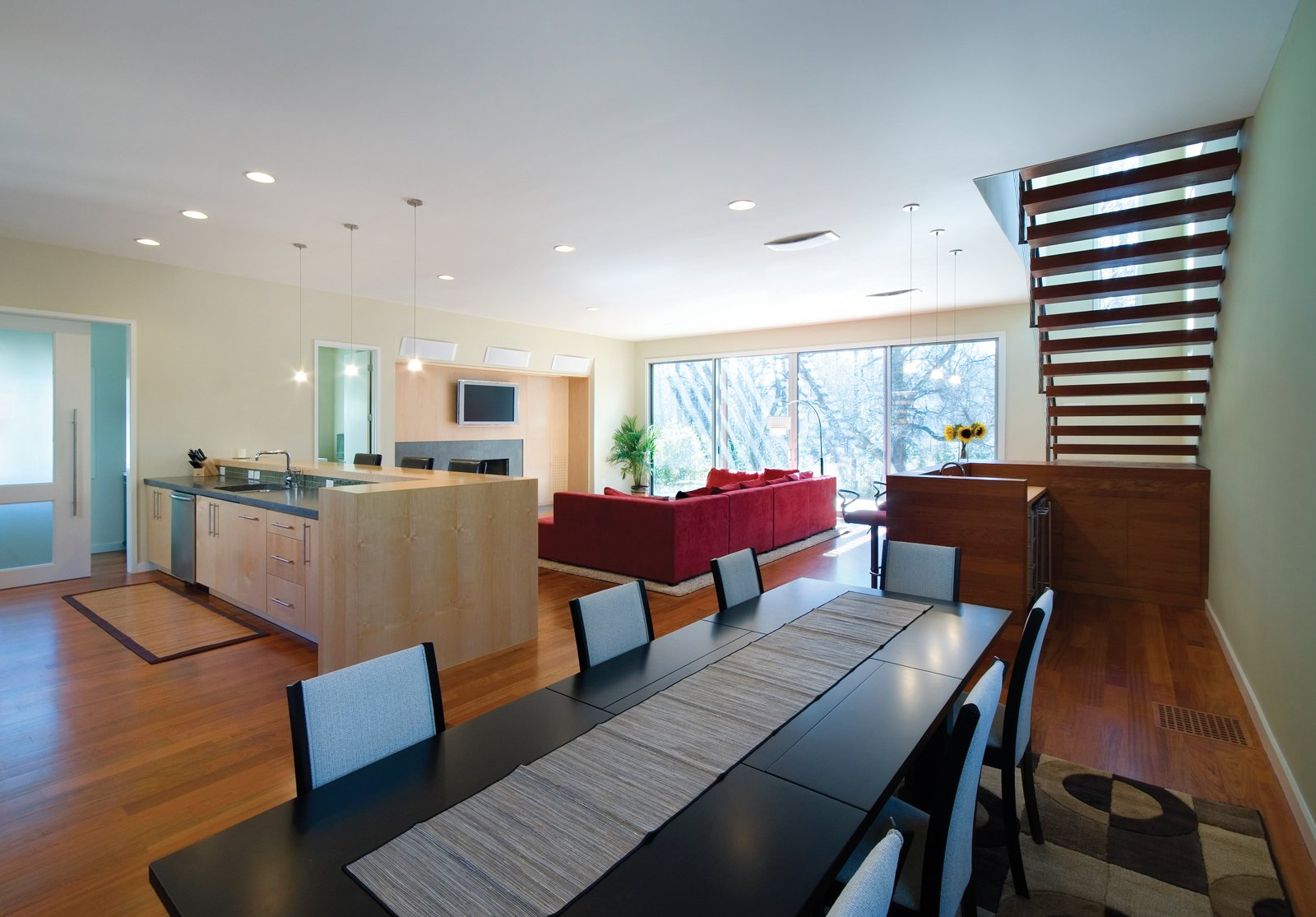 This approach allows for an extremely efficient use of space, leaving the smaller, existing bedrooms and living areas to be used as guest spaces and the new construction to be as large and open as possible. The material palette remains in context, while the execution and form make a decidedly modern statement.  Photo 3 of 30 in Triangle House Tours