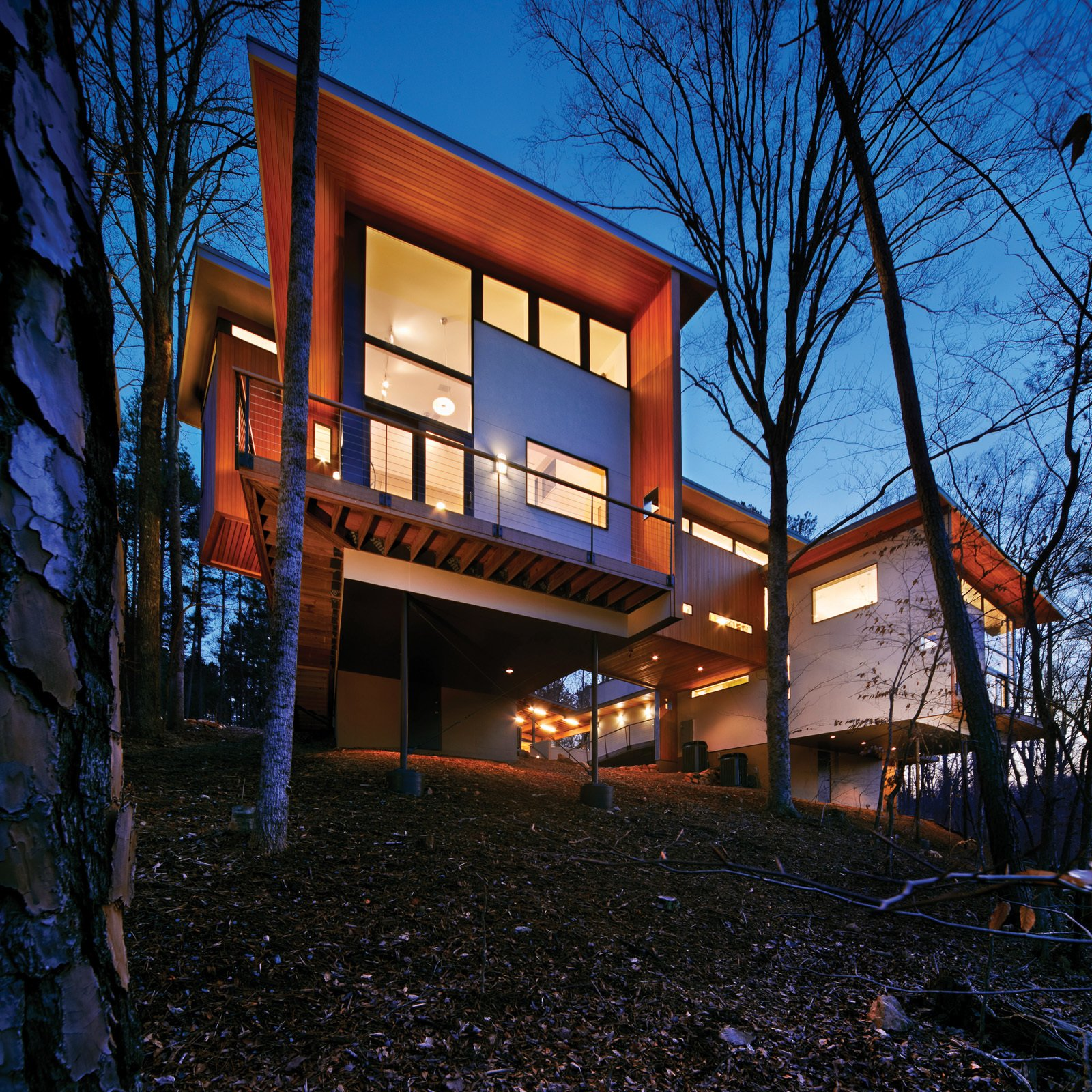 The complex, perched on a slope overlooking a forest owned by Duke University, has an 800-square-foot artist's space and a 2,400-square-foot house.  Photo 5 of 30 in Triangle House Tours