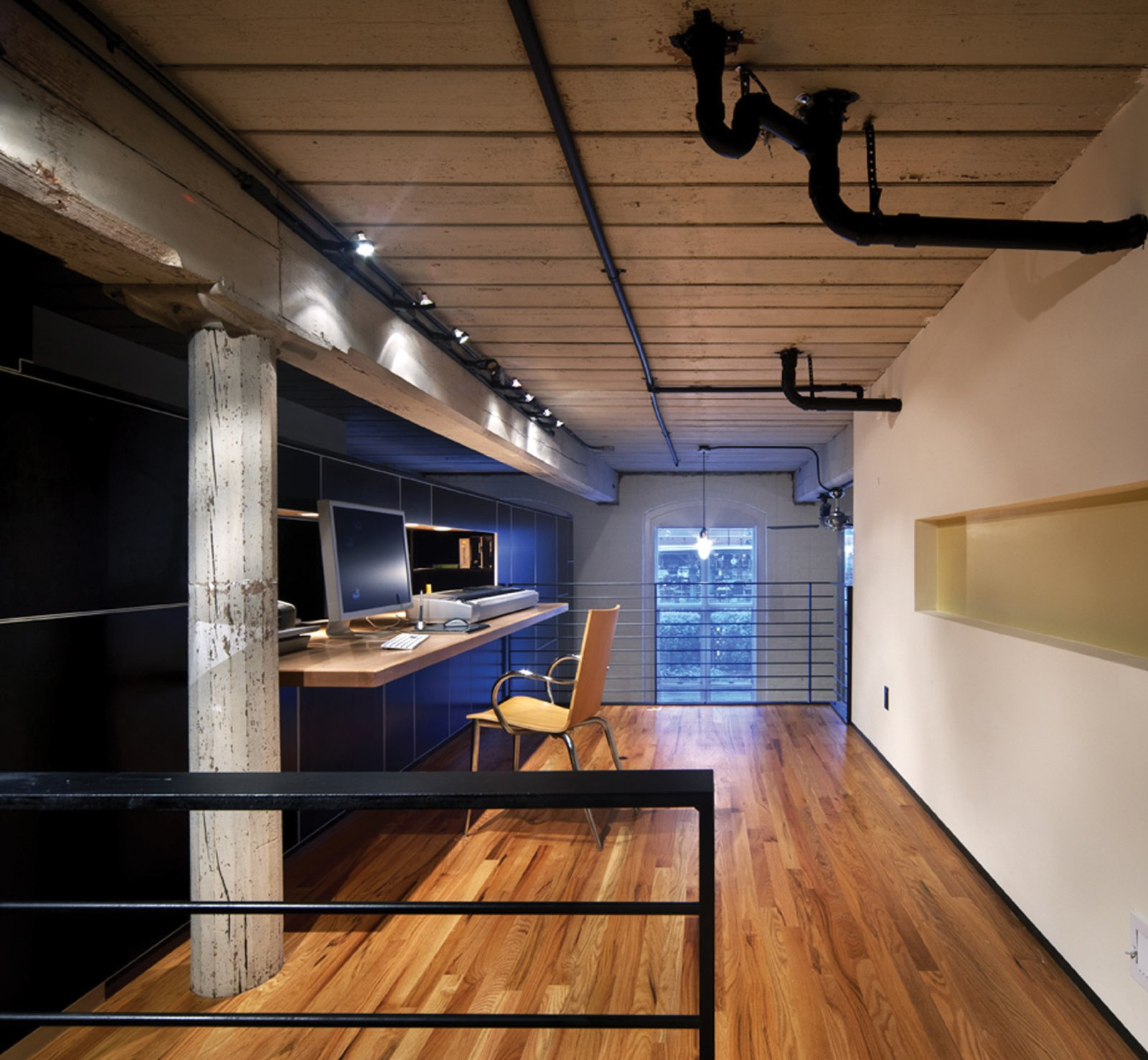 The addition of a loft increases square footage, providing a larger, more private office/workspace.  Photo 21 of 30 in Triangle House Tours