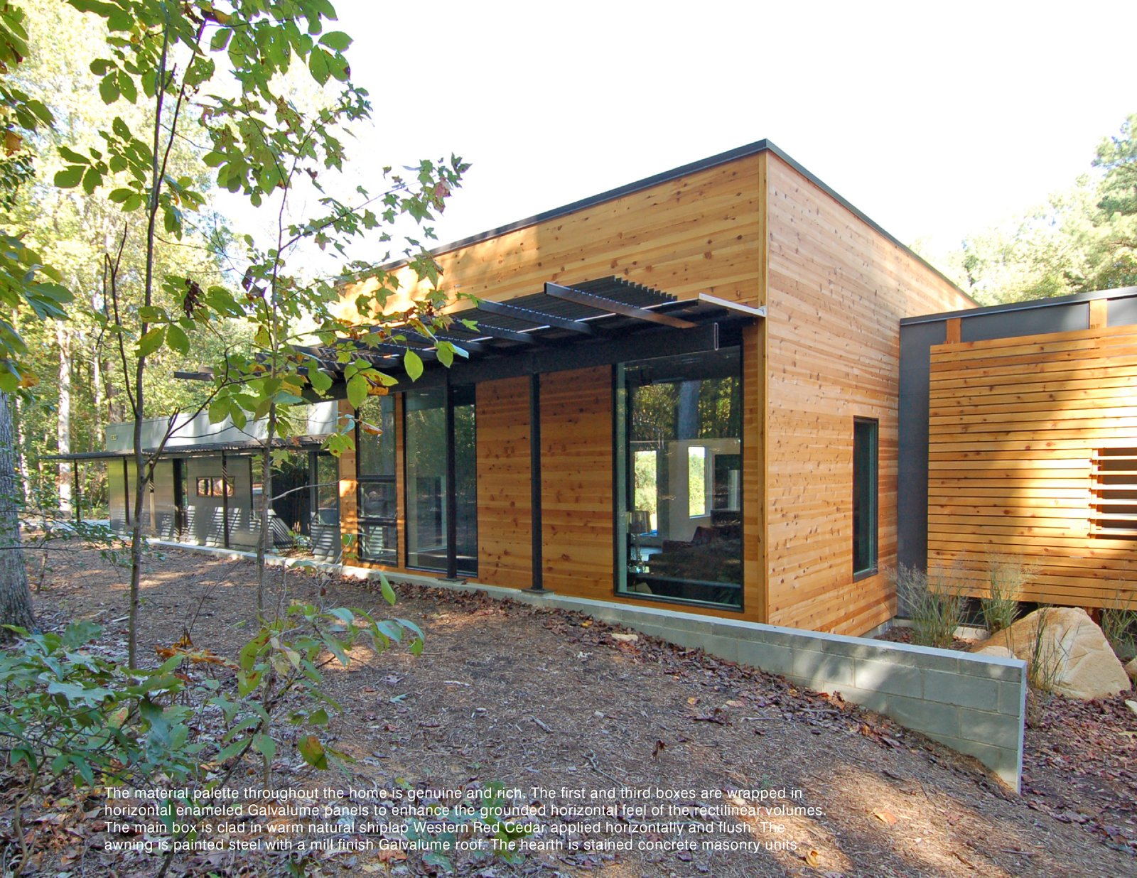 The single story home designed by Studio B Architecture is comprised of three rectangular forms, the central and tallest of which contains the primary living space.  Photo 28 of 30 in Triangle House Tours