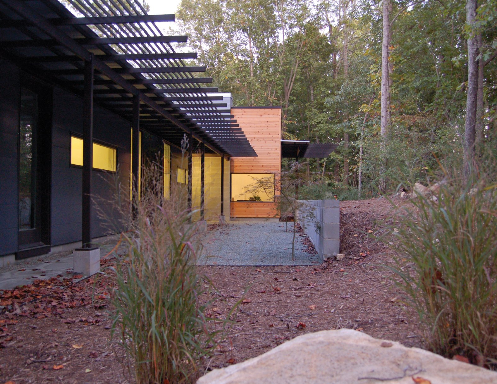 The Zuco home is modern, comfortable, light filled and energy efficient. A great example of a living space designed with thoughtful consideration of both the interior and exterior environments.  Photo 29 of 30 in Triangle House Tours