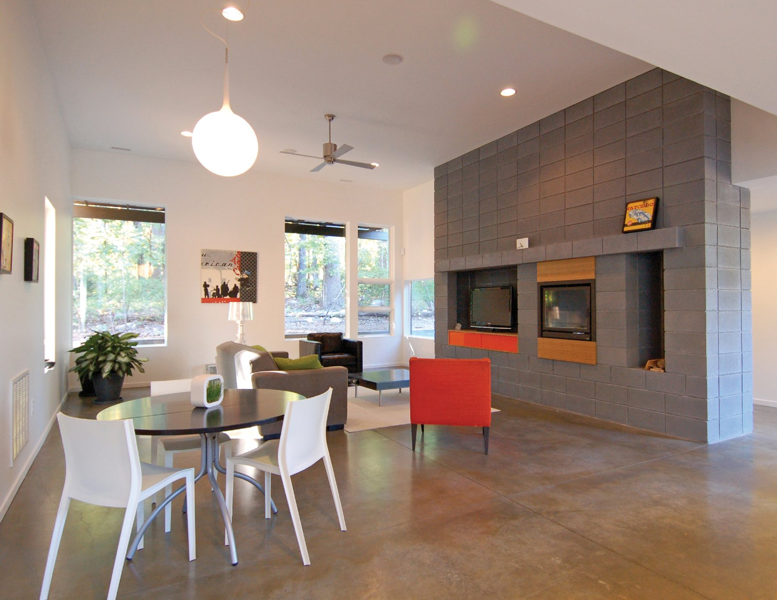 A concrete block hearth serves as the focus of the main living area as well as the delineation of the main entrance.  Photo 30 of 30 in Triangle House Tours