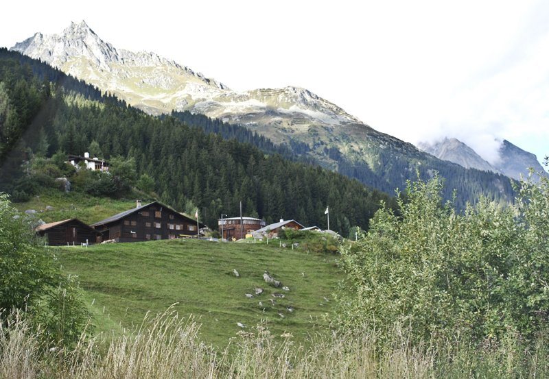 Unassuming, yet exceedingly elegant, the chapel is very petite next to the neighboring houses (and the Alps in the background), and blends in well with its environment.  A Pilgrimage to Zumthor's Chapel by Tiffany Chu