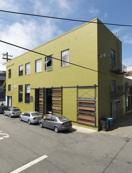 The 1940s-era building was scheduled for demolition before the Sands purchased it in the early aughts and transformed it into their workshop, offices, and home. The space was nearly in ruins when the couple bought it and they used recycled or salvaged materials wherever possible in the renovation and even fabricated the metal work in the first-floor shop.