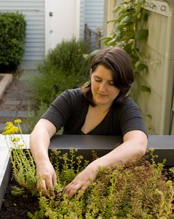 Native Oregon sedums grow on the coop's green roof. Elsewhere in the garden, Martin harvests lettuce, radishes, snap peas, onions, carrots, potatoes, and a cornucopia of other vegetables.