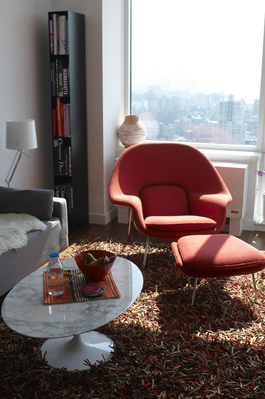 A Hella Jongerius vase for Ikea, Saarinen chair and table, and a Nani Marquina rug fill this sunlit apartment.  Blu Dot Spotted