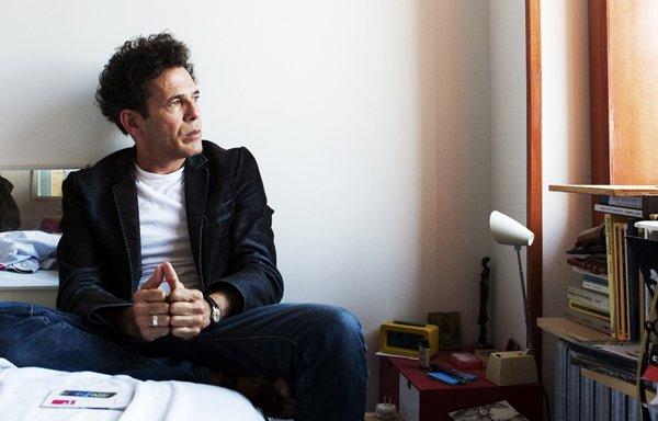 The poet Armando in his Williamsburg home.