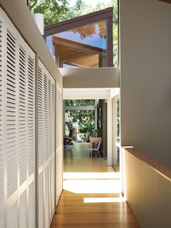 The bridge leads from the living room to the bedrooms and from the studio to the garage.