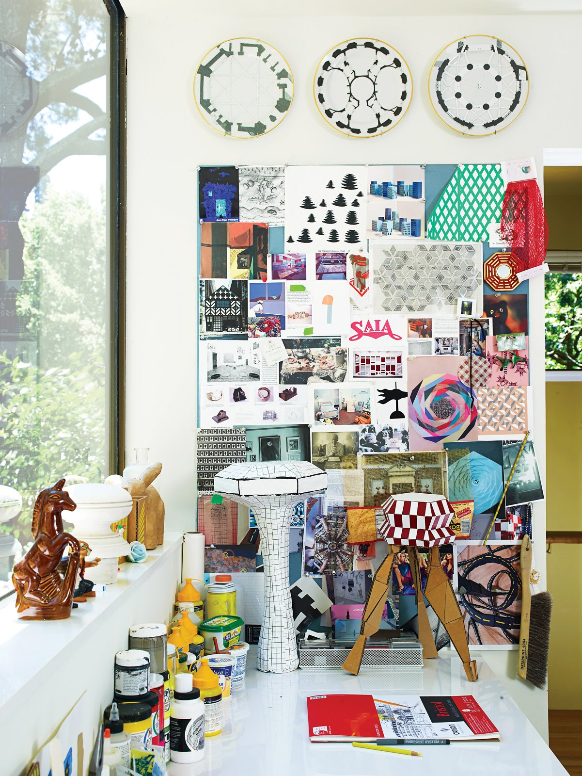 """Office and Desk Inspiration crowds Alexander's studio desk.  Search """"how giant windows"""" from Undivided Intentions"""