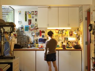 A garage full of cupboards can't contain Orpilla's toolkit.
