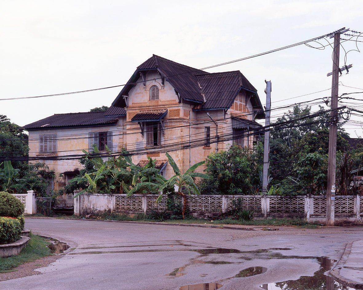 "These colonial houses are around the old center of town. They were originally residential houses built between 1914 and 1930 for the French colonial officials and administrators. The French brought Vietnamese masons and carpenters since they were already trained to build French style houses. Most of these laborers settled in Ban Anou, the old Vietnamese ""village"" in Vientiane.  Photo 2 of 14 in Living in Laos"