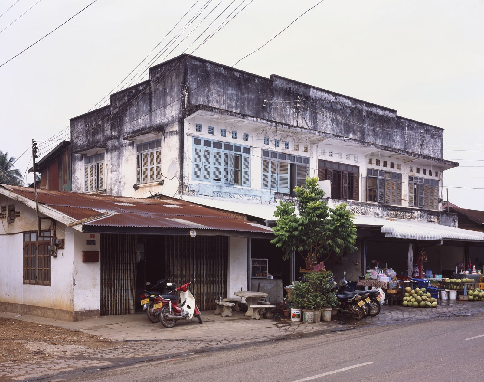 This building is fairly common in Vientiane, with the storefront at the bottom and living quarters in back and on top.  Photo 13 of 14 in Living in Laos