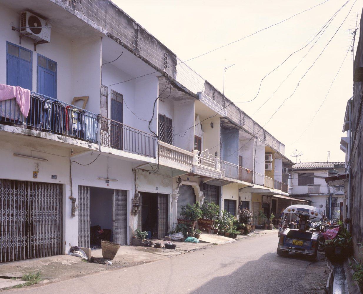 This is an example of a non-commercial street dating back to the 1960s. I love the one house in the middle that is so ornate—it really stands out.  Photo 14 of 14 in Living in Laos