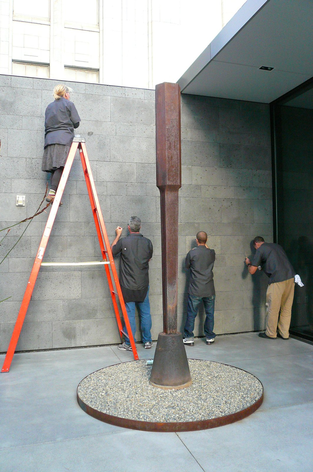 The crew hard at work, in the shadow of a sculpture.  World's First Lichen Garden? by Jaime Gillin