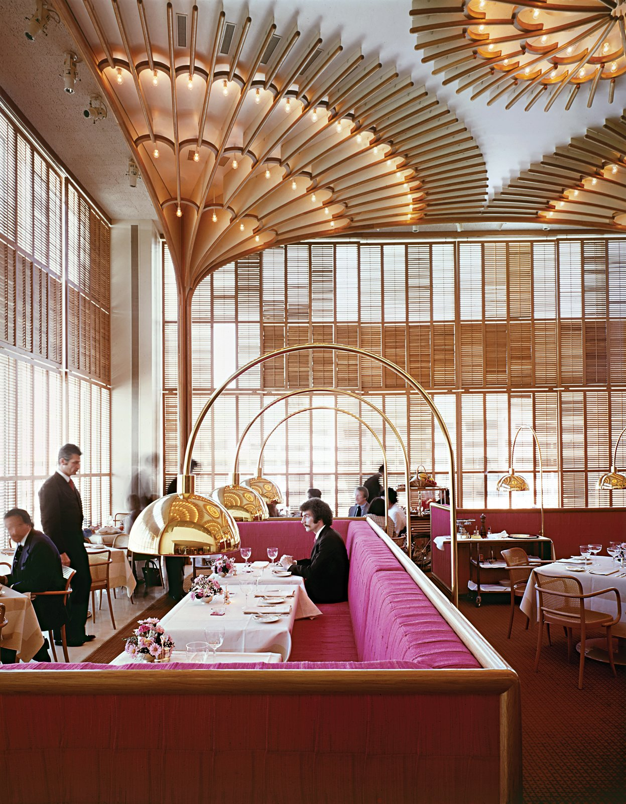 "Warren Platner designed the American Restaurant in Kansas City in 1974 as part of a complex of modern buildings commissioned by the Hall family of Hallmark Cards. He described the bentwood, brass and lipstick-red interior as ""like a huge lace Valentine.""  Timeless Iconic Design from The Opulent Modernism of Platner"