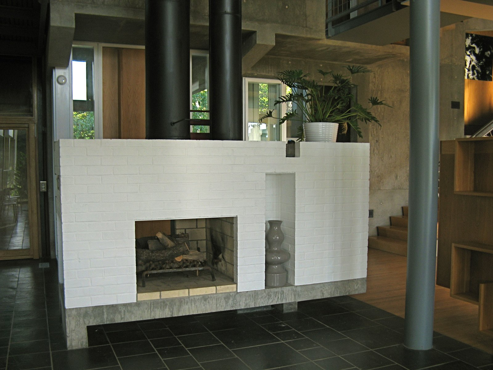 The hearth is central, and like the rest of the house, reassuring in its classism, in both proportion and assembly. While in a way austere, the richness of material keeps the house from feeling cold or operational. Still, it has to be understood as an exercise in Architecture for architectures sake, high couture, embracing certain abstract ideas of architecture and not necessarily a practical application in society.  Photo 4 of 10 in Modern in Lexington, Kentucky