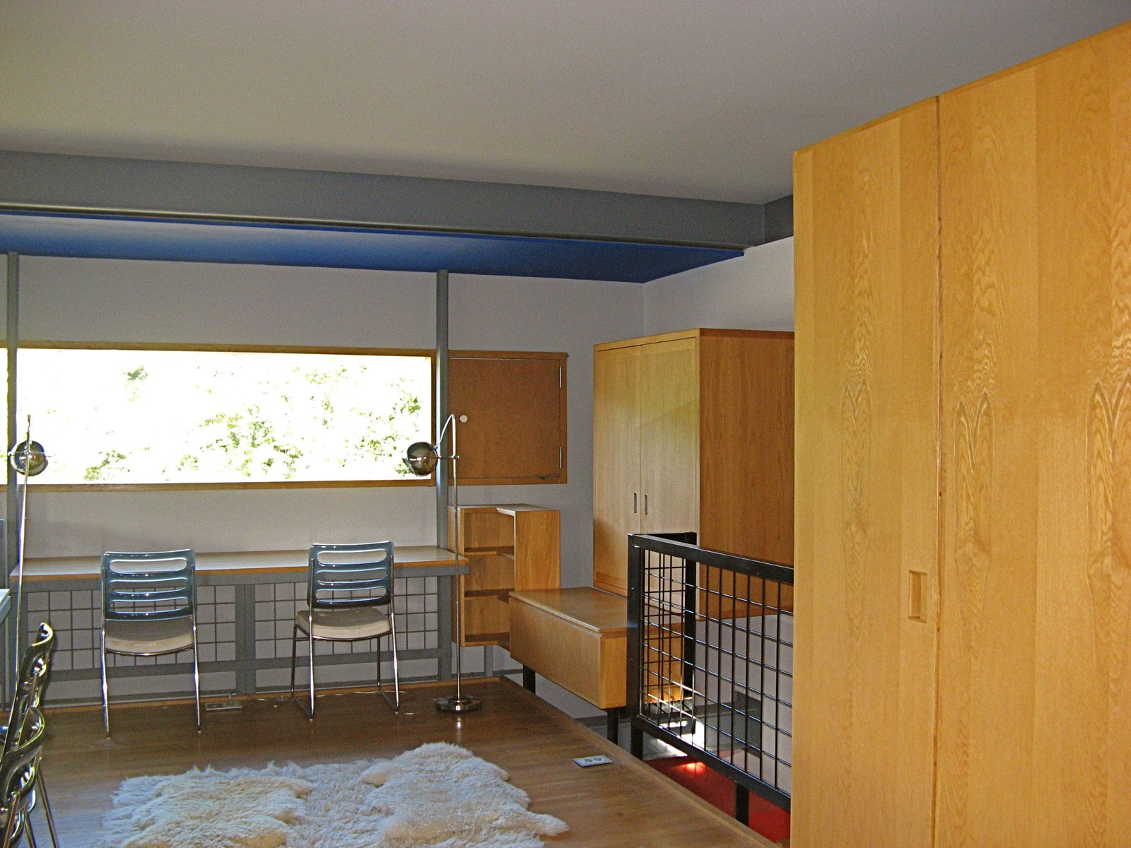 """A view of one of the boys' bedroom shows how the furniture was built into the wall and the relationship of walls to the floor, making clear, as Guyon has described, that this is really """"an experiment masquerading as a house."""" As is indicative of a pure Modernist home, all glass is fixed, with separate screened compartments for ventilation. Circulation and places of repose are also separated. As one can see at the right of the frame, the box is denied, the cube explodes, things come apart and nothing directly touches. """"Its not egalitarian, its completely elite. Though many find it to be bare bones, its just really intense in its craft,"""" says Guyon.  Photo 9 of 10 in Modern in Lexington, Kentucky"""