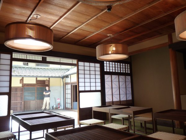 Inside the restaurant/teahouse. Sticotti designed the wooden tables, stools, and lighting fixtures.