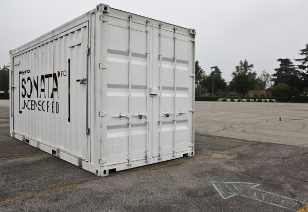 A refurbished shipping container was used as the basic building block to create the installation. Extremely portable and an innovative way to re-think and re-use a seemingly single purpose object.