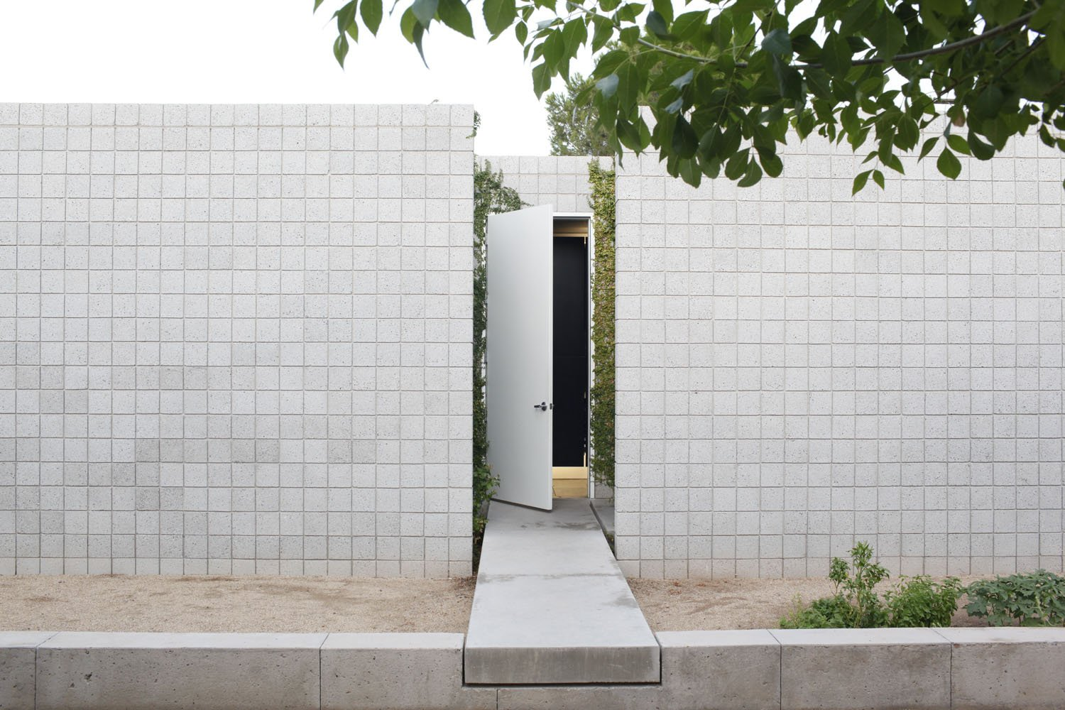 Doors and Exterior The front door is accessed by a 'floating' concrete bridge that bisects the two wings of the house.  Photo 6 of 7 in Photographer Q&A: Ye Rin Mok from Startin' Spartan