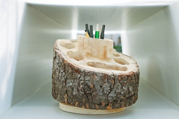 Stock—–like Aaron Linn's hand-carved Log Desk Organizer—–can rotate as often as the meter runs out.