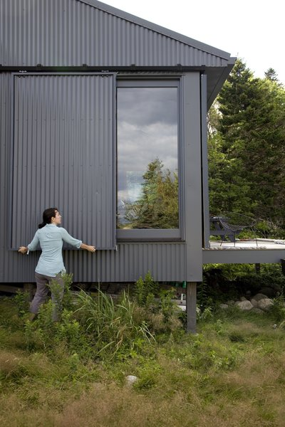 When Alex or Bruce leave the island, closing up shop is as simple as sliding panels of corrugated metal into place to protect the windows.