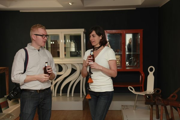 Here Aaron Able of Apartment Therapy chats with Paulina who owns ADN with her husband Paulo. In the background is a small white chair by Ariel Rojo and a seemingly in-motion chest by EOS Mexico Studio.